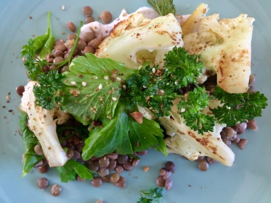 Blackened cauliflower salad with green lentils, clergy leaf, parsley and dairy-free yoghurt.