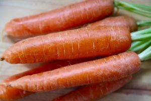 Fresh carrots on a table.